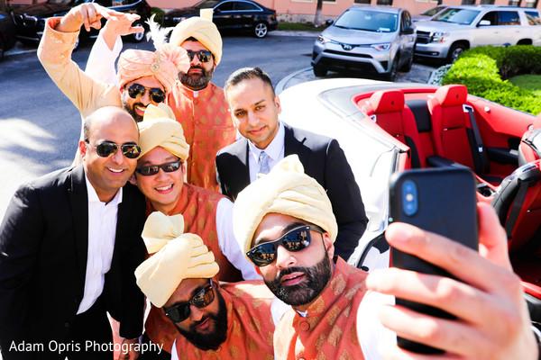 Indian groomsmen taking a selfie with groom.