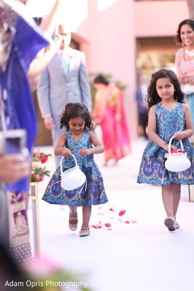 Lovely Indian flower girls walking down the aisle.