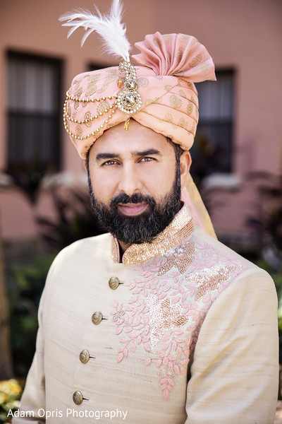 Handsome indian groom on his ceremony outfit.