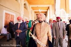 Indian groom holding the kirpan