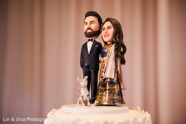 Dolls of the couple on top of the cake