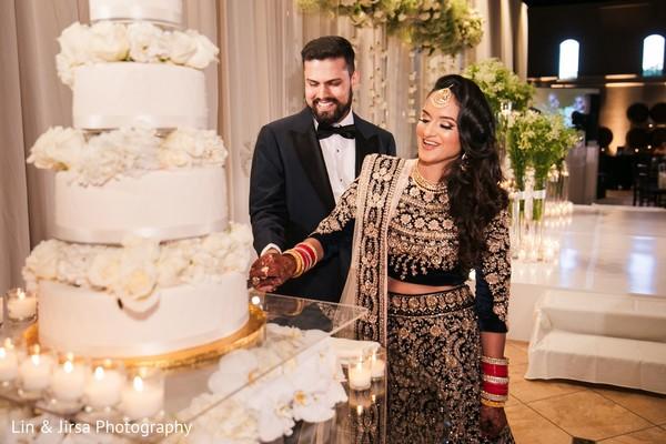 Maharani cutting the cake with the Raja