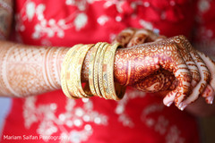 Indian bride with her golden bangles close up.