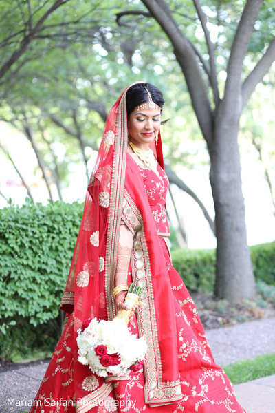 Sweet Indian bride about to meet the groom.