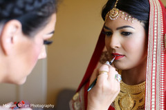 Last touch ups of Indian bridal makeup.