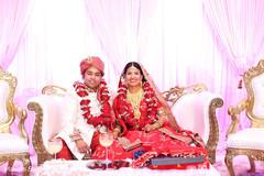 Glamorous indian couple during wedding ceremony.