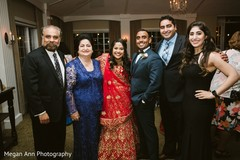 Glamorous Indian bride and groom with guests.