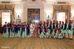 Indian couple posing with special guests