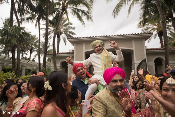 Indian groom being lifted by special guests