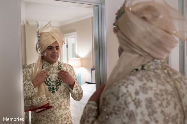 Indian groom getting ready with sherwani