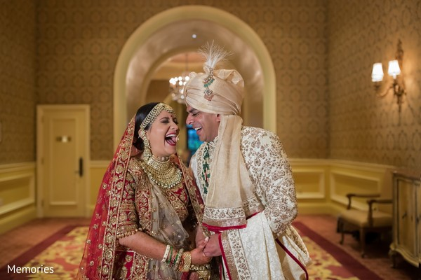 Indian bride and groom having a laugh