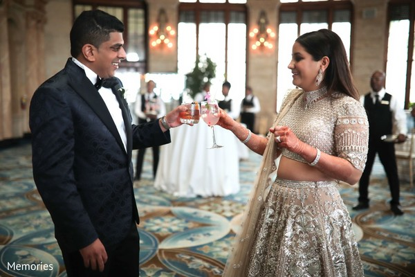 Indian bride and groom having a toast