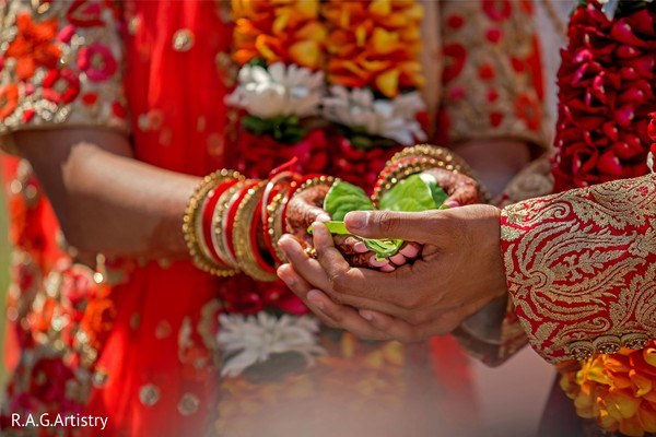 Indian couple holding the leaf ritual.