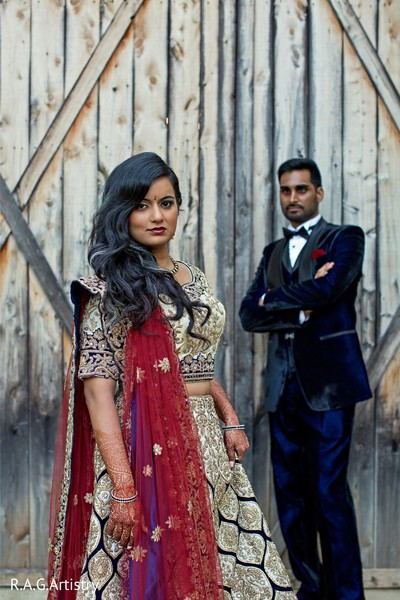 Elegant Indian bride and groom on their mehndi party outfits.