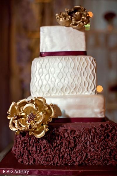 Magnificent Indian wedding cake golden flowers decoration.