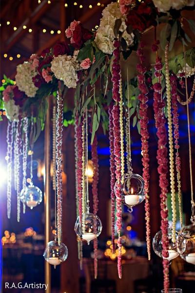 Indian wedding hanging candles decor.