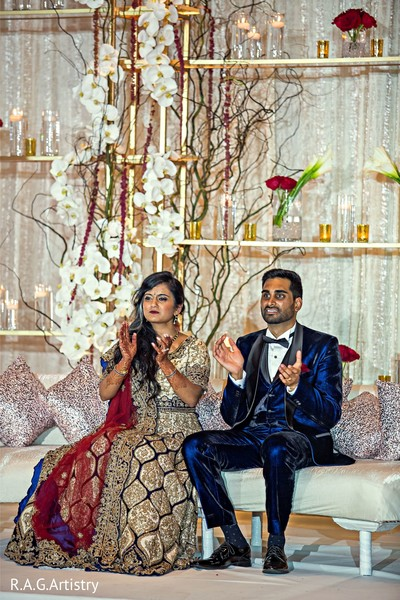 Indian couple enjoying their reception party.