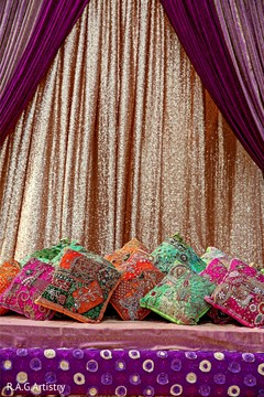 Colorful Indian mehndi stage decor.