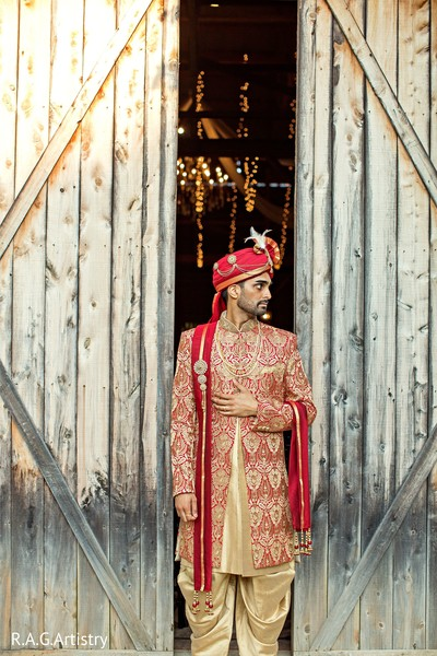 Charming Indian groom on his ceremony outfit.