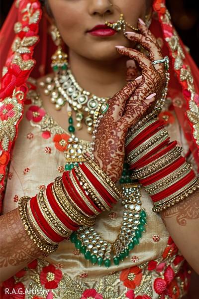 Stunning Indian bridal choora and mehndi art.