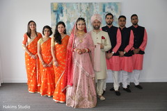 Elegant Indian couple with bridesmaids and groomsmen .