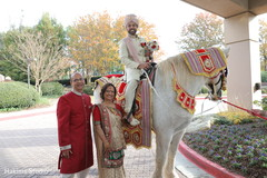Marvelous Indian groom on his baraat white horse.