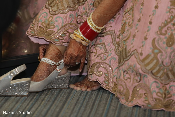 Maharani putting her shoes on.