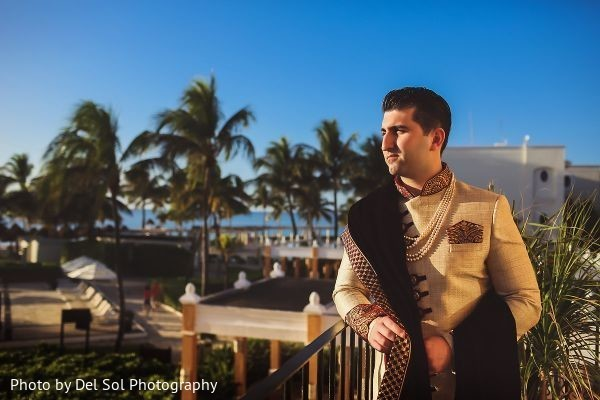 Charming Indian groom posing outdoors.