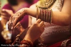 Indian bride putting her ceremony choora.