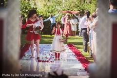 Lovely Indian flower girls at ceremony aisle.