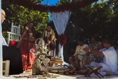 Lovely Indian wedding ceremony Ganesha Puja decor.