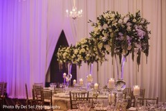 Elegant indian wedding table flowers decor.