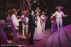 Indian couple having fun with the Mariachis.