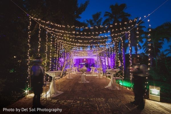 Marvelous Indian wedding reception outdoors lights decoration.