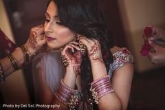 Maharani putting her sangeet earring on.