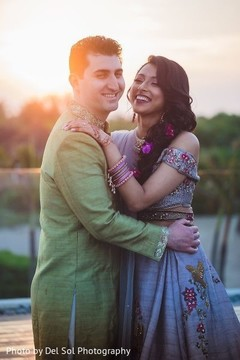 Lovely Indian  bride and groom smiling.