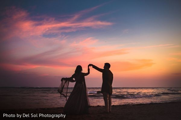 Marvelous Indian couple's sangeet photo session by the beach.