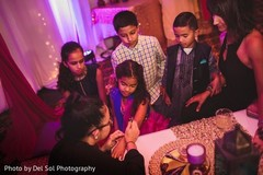 Lovely Indian sangeet guests getting mehndi art done.