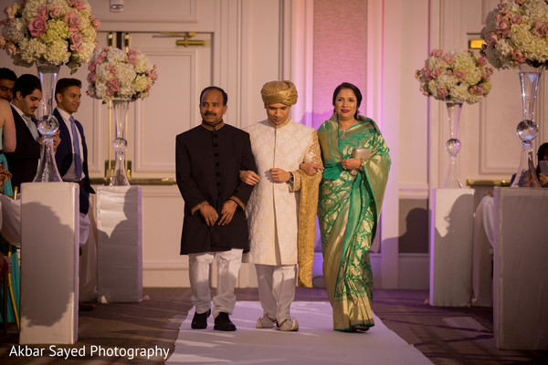 Indian groom entering his wedding ceremony.