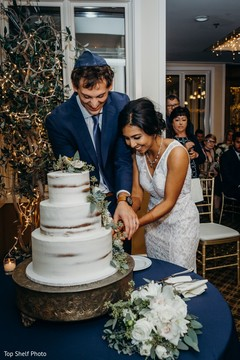 Indian lovebirds cutting the cake moment.