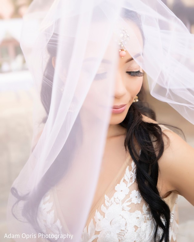 Magical outdoors capture of bride on her white wedding dress.