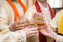 Indian groomsmen toasting for the newlyweds