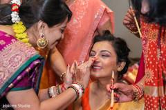 Beautiful indian bride at her Gaye Holud celebration.