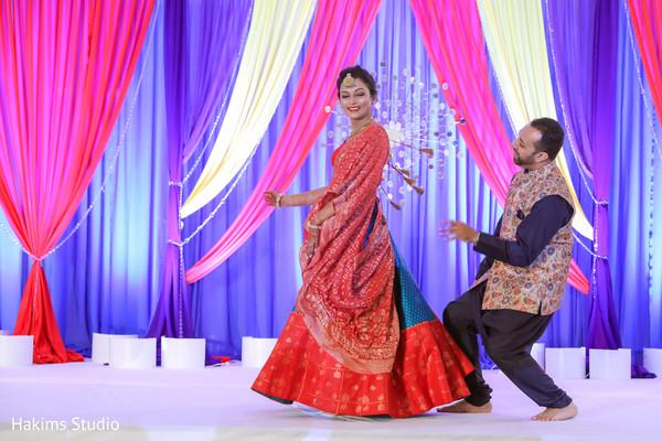 Indian couple at a sangeet dance capture.