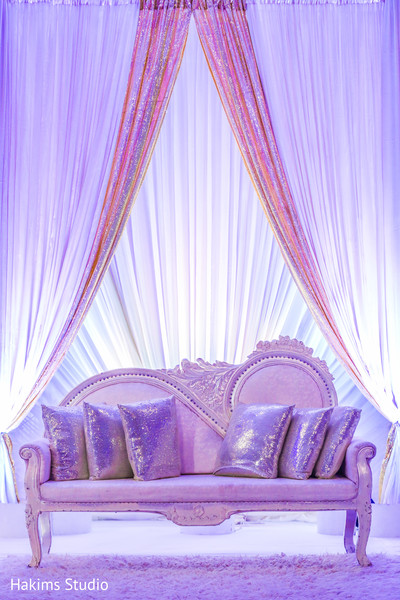 Dreamy Indian wedding reception stage couch.