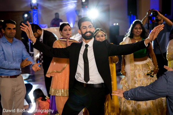 Adorable indian groom dancing capture.