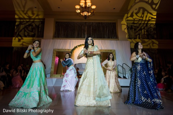 Gleeful indian bridal reception dance performance.
