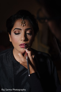 Maharani being assisted by makeup artist