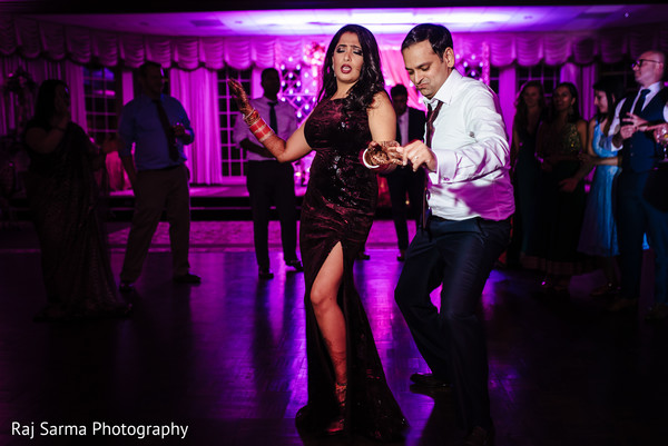 Gorgeous bride dancing with Raja