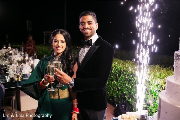 Indian bride and groom during toasts